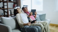 Senior Couple Playing Game with Virtual Reality Goggles