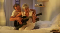 HD DOLLY: Senior Couple Playing The Guitar