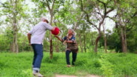 Senior couple playing with a ball in the park, Delhi, India