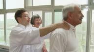 HD: Senior Couple Practicing Massage Techniques