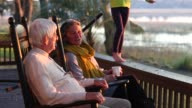 Senior couple relaxing in rocking chairs on vacation