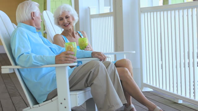 MS PAN Senior couple relaxing together on porch, Eastville, Virginia, USA