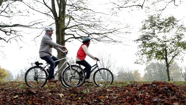 Senior couple riding their bikes
