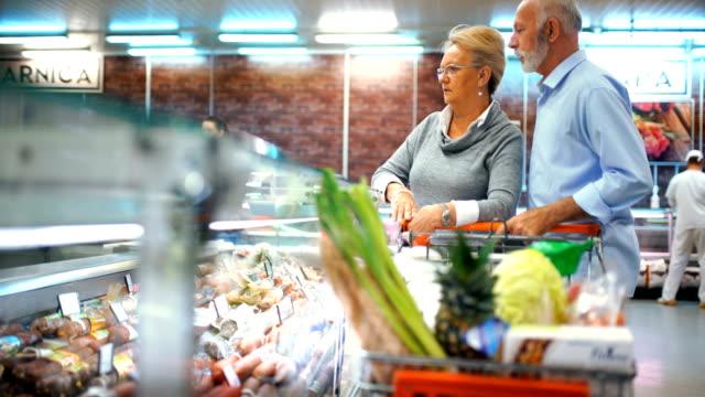 Senior couple shopping in supermarket.