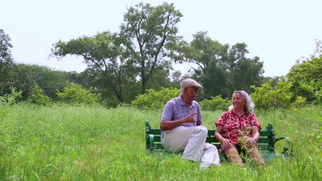 Senior couple sitting in the park, Delhi, India
