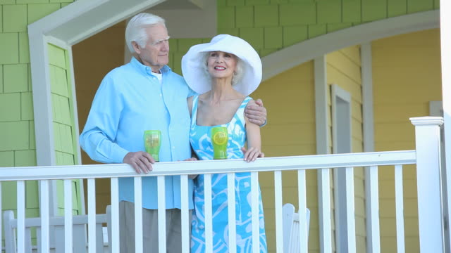 MS PAN Senior couple standing together on deck of beach resort, Eastville, Virginia, USA