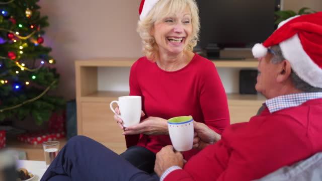Senior couple talking and drinking tea