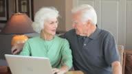 MS TD Senior couple using laptop at home, Eastville, Virginia, USA