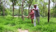 Senior couple walking in the park, Delhi, India