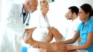 Senior doctors examining patients