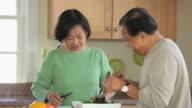 MS Senior husband and Wife Preparing Salad in Kitchen / Eastville, Virginia, USA
