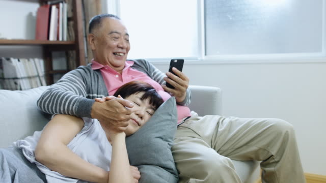 Senior Japanese Couple Relaxing at Home