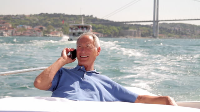 Senior male calling on yacht