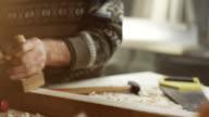 Senior male carpenter working
