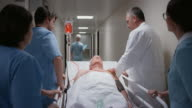 DS Senior male patient going to the OR with the medical team
