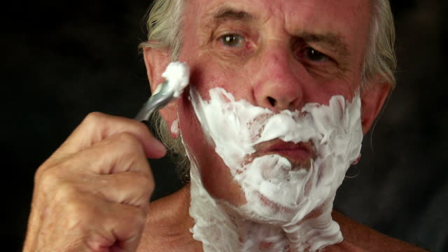 senior male shaving