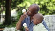 'MS, Senior Man and Grandson Eating Ice Cream Cones, Richmond, Virginia, USA'