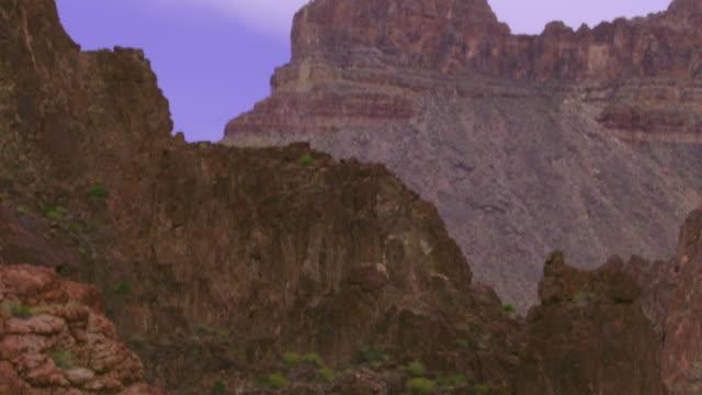 WS TD PAN SLO MO Senior man and woman piloting dory through large rapids / Grand Canyon, Arizona, USA
