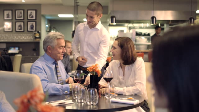 MS Senior man asking for bill from waiter