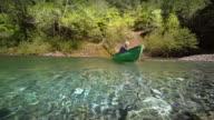 Senior man canoeing on river, Oregon