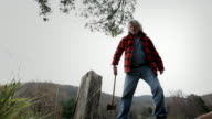 WS Senior man chopping wood with axe / Kingston, New York, USA