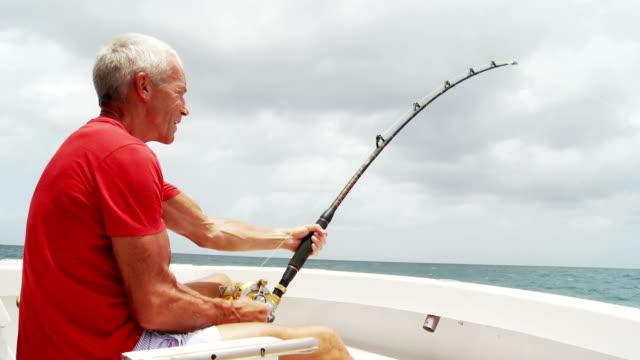Senior man deep sea fishing