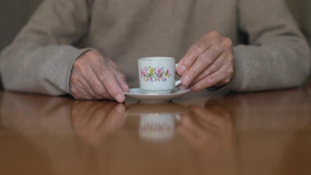 Senior man drinking a greek coffee
