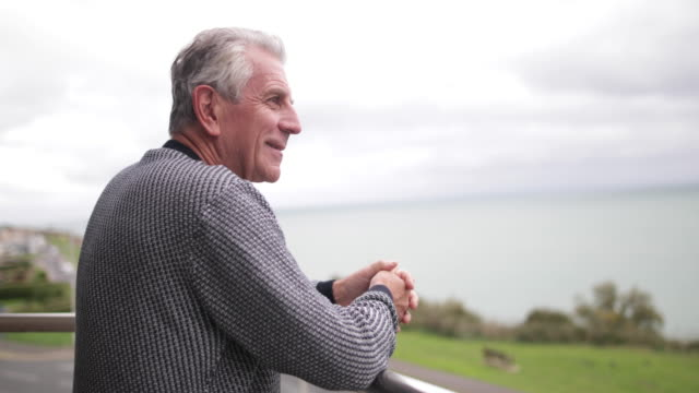 Senior man enjoying sea view