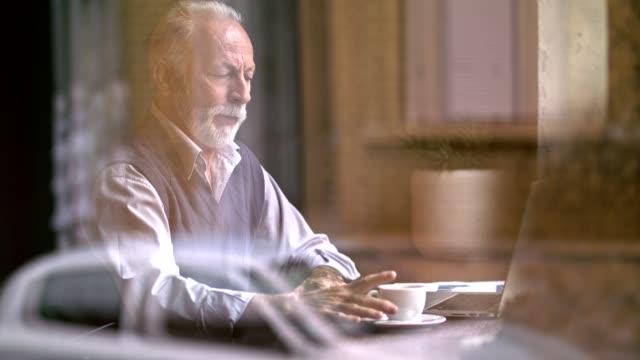 Senior man in a cafe