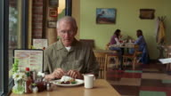MS, Senior man in diner getting check