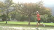 Senior man jogging in a park