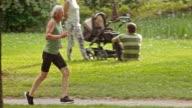 SLO MO TS Senior man jogging in the park