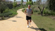 Senior man jogging on path