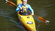 Senior Man Kayaking in Nature - HA