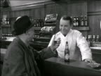 B/W 1942 senior man on barstool drinking beer + chatting with bartender / pays him + leaves