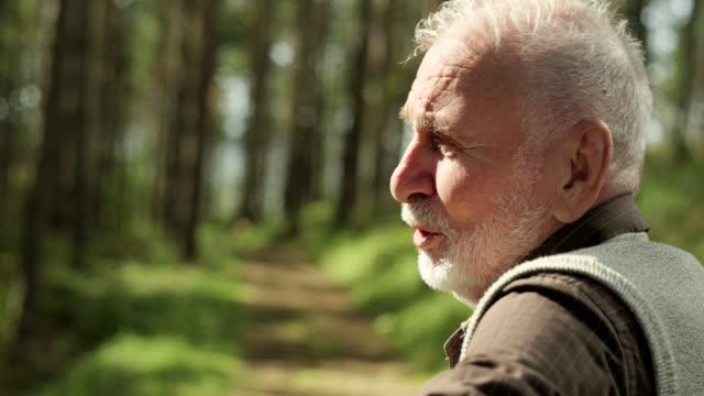 Senior man on park bench talking with somebody