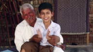 Senior man playing with his grandson, Haryana, India