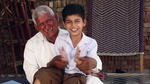 Senior man playing with his grandson, Haryana, India