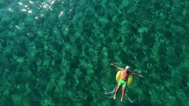 Senior man relaxing in the ocean