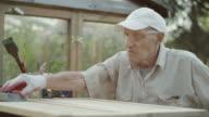 Senior man renovating old furniture