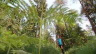 SLO MO CS Senior man running on a forest trail