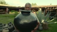 MS Senior man - son of famous Dona Rosa showing traditional barro negro pottery / Oaxaca, Mexico