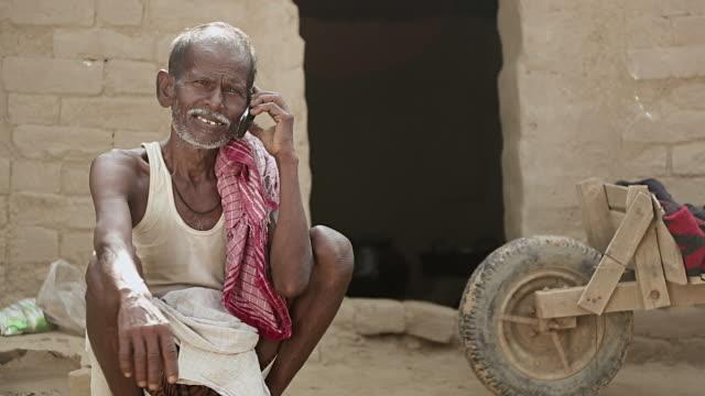 Senior man talking on a mobile phone, Haryana, India