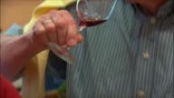 CU TU Senior man tasting wine / Provence, France