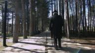 Senior man walking with walking cane