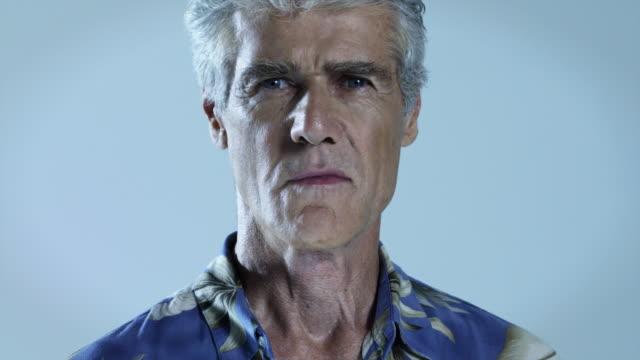 Senior man wearing hawaiian shirt