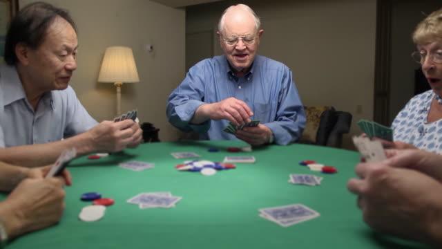 Senior Man Wins at Card Game