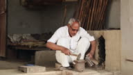 Senior man working in the workshop, Haryana, India
