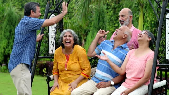 Senior men and senior women enjoying in the park, Delhi, India