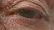 ECU Senior person's blue eye opening